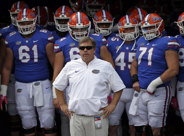 Former Florida coach Jim McElwain is now the wide receivers coach at Michigan. (AP Photo/John Raoux, File)