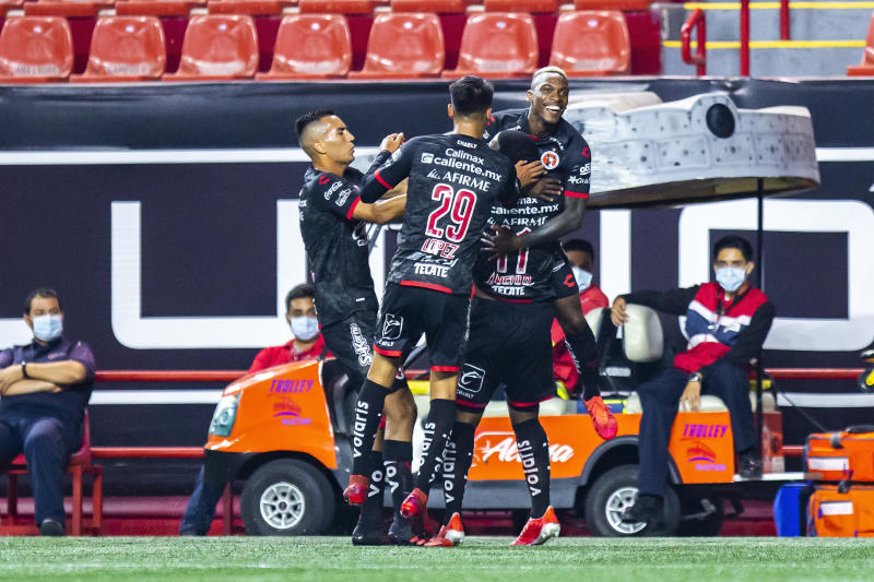 TIJUANA, MEXICO - SEPTEMBER 04: Players of Tijuana Christian Rivera, Ivan Lopez and Bryan Angulo celebrate with Fabian Castillo after he scored the second goal of his team during the 8th round match between Tijuana and Monterrey as part of the Torneo Guard1anes 2020 Liga MX at Caliente Stadium on September 4, 2020 in Tijuana, Mexico. (Photo by Francisco Vega/Getty Images)