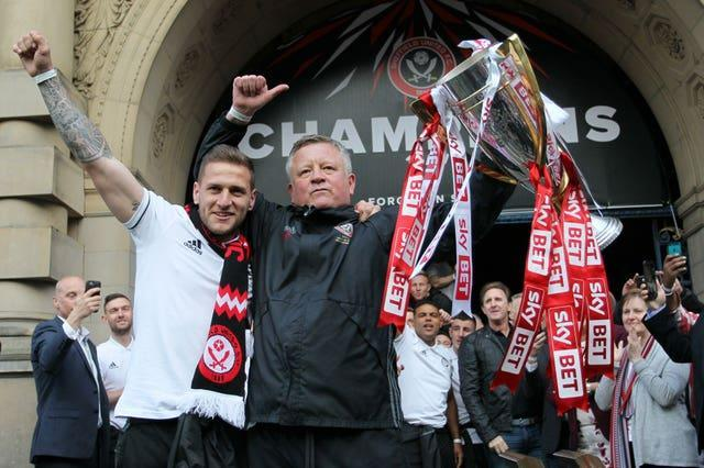 Sheffield United manager Chris Wilder and captain Billy Sharp with the League One trophy