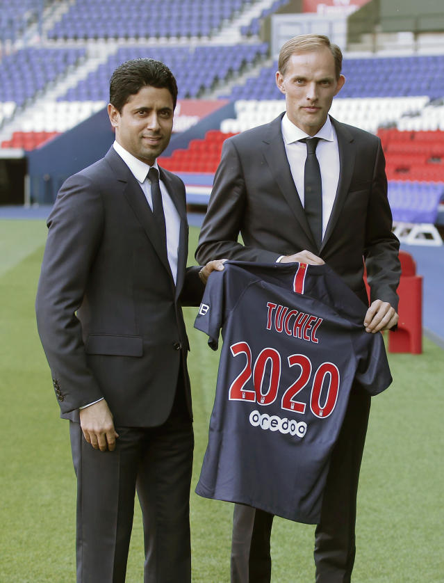 PSG President Nasser al-Khelaif, left, and new Paris Saint-Germain coach Thomas Tuchel pose with a shirt at Parc des Prince stadium in Paris, France, Sunday, May 20, 2018. The 44-year-old German joined PSG on a two-year deal. He replaces Unai Emery, whose two-year contract was not renewed after PSG again failed to get far in the Champions League. (AP Photo/Michel Euler)