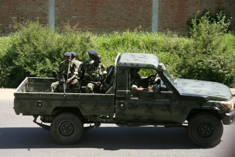 Military personnel patrol the Musaga neighbourhood of Bujumbura, Burundi on December 11, 2015