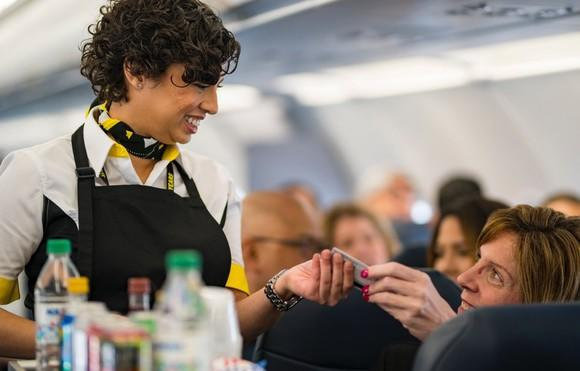 Spirit Airlines stewardess serving passenger