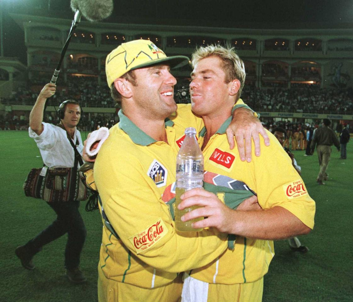 14 Mar 1996:  Mark Taylor and Shane Warne of Australia celebrate after winning the Semi Final match between Australia and West Indies played at Chandigarh. Mandatory Credit: Shaun Botterill/ALLSPORT