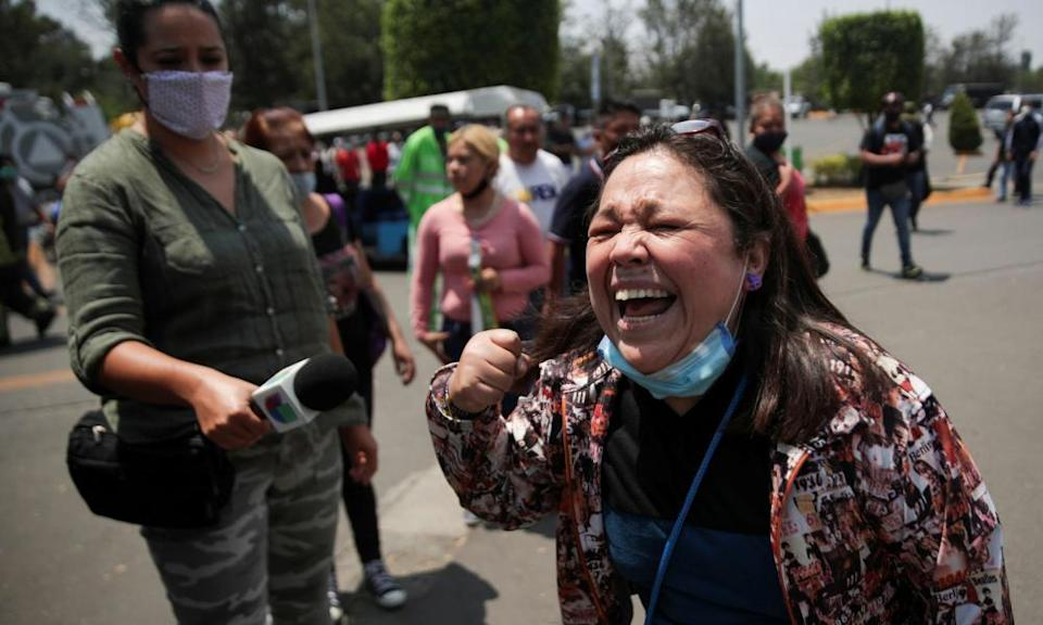 A resident reacts as she arrives at the crash site at Los Olivos station in Mexico City on Tuesday.