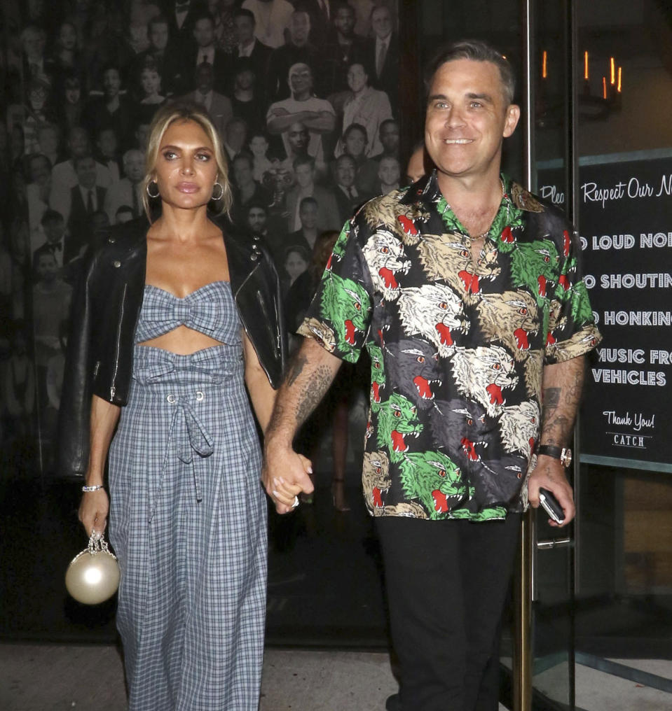 Photo by: GOTPAP/STAR MAX/IPx 2018 9/14/18 Robbie Williams and Ayda Field are seen outside Catch Seafood Restaurant in West Hollywood, Los Angeles, CA.