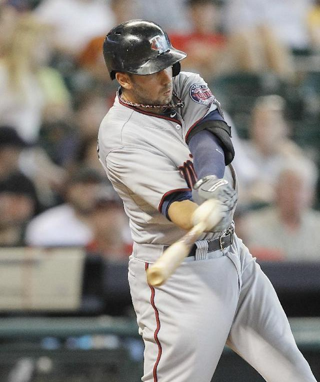 Minnesota Twins' Chris Colabello (55) hits a home run against the Houston Astros in the fourth inning of a baseball game Monday, Sept. 2, 2013, in Houston. (AP Photo/Bob Levey)