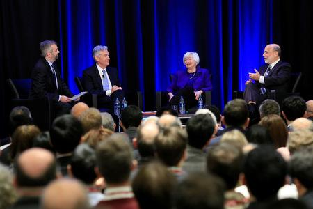 U.S. Federal Reserve Chairman Jerome Powell, former Fed chairs Janet Yellen and Ben Bernanke (R) participate during a panel discussion moderated by Neil Irwin (L), at the American Economic Association/Allied Social Science Association (ASSA) 2019 meeting in Atlanta, Georgia, U.S., January 4, 2019.  REUTERS/Christopher Aluka Berry