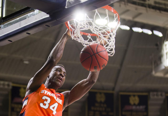 Syracuse's Bourama Sidibe(34) dunks during the second half of an NCAA college basketball game against Notre Dame on Wednesday, Jan. 22, 2020, in South Bend, Ind. Syracuse won 84-82. (AP Photo/Robert Franklin)