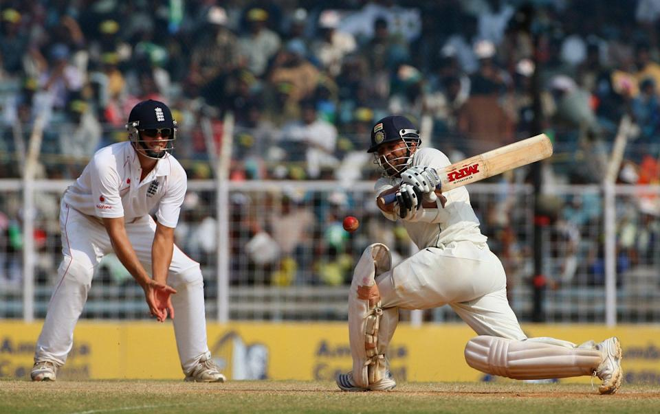 Sachin Tendulkar of India hits out as Alastair Cook of England looks on during day 5 of the First Test Match between India and England at the MA Chidambaram Stadium on December 15, 2008 in Chennai, India - Global Cricket Ventures/BCCI via Getty Images