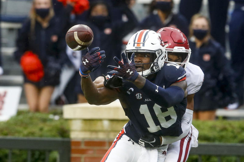 Auburn wide receiver Seth Williams (18) had a rough day catching the football against Arkansas. (AP Photo/Butch Dill)