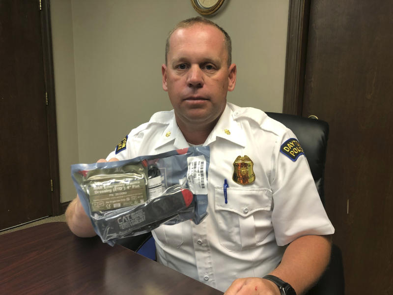 In this Sept. 4, 2019 photo, Dayton, Ohio, Police Maj. Chris Malson, a veteran police training leader, displays the first aid supplies that police carry with them, during an interview at the West Patrol Operations division in Dayton, Ohio. Dayton police were praised for their quick work to stop the bleeding of wounded victims of the city's Aug. 4 mass shooting, an example of the increased medical role of police. (AP Photo by Dan Sewell)