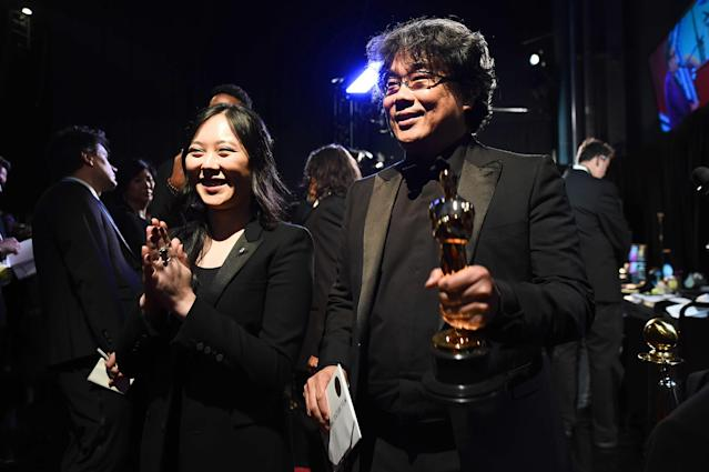 Sharon Choi and Best Director award winner Bong Joon Ho pose backstage during the 92nd Annual Academy Award. (Photo: Matt Petit - Handout/A.M.P.A.S. via Getty Images)
