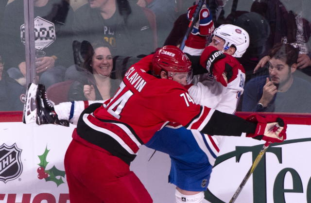 Montreal Canadiens' Brendan Gallagher is checked by Carolina Hurricanes' Jaccob Slavin during the second period of an NHL hockey game, Thursday, Dec. 13, 2018 in Montreal. (Paul Chiasson/The Canadian Press via AP)