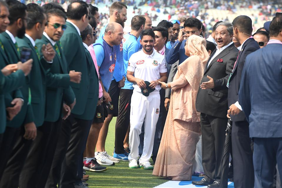 Bangladesh's Prime Minister Sheikh Hasina (4th R) speaks with Bangladesh's cricket team captain Mominul Haque (C) before the start of the first day of the second Test cricket match of a two-match series between India and Bangladesh at The Eden Gardens cricket stadium in Kolkata on November 22, 2019. (Photo by Dibyangshu SARKAR / AFP) / IMAGE RESTRICTED TO EDITORIAL USE - STRICTLY NO COMMERCIAL USE