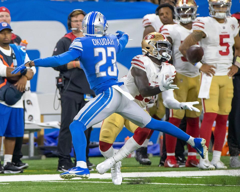 San Francisco 49ers receiver Deebo Samuel makes a catch in front of Detroit Lions cornerback Jeff Okudah in the third quarter and runs for a 79-yard touchdown at Ford Field, Sept. 12, 2021.