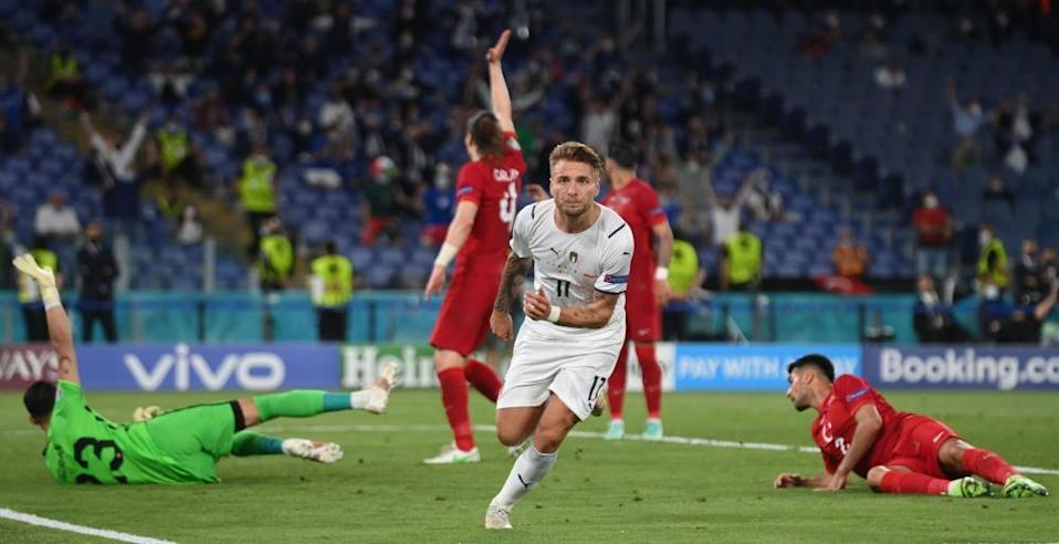 Ciro Immobile celebrates after putting Italy 2-0 ahead.
