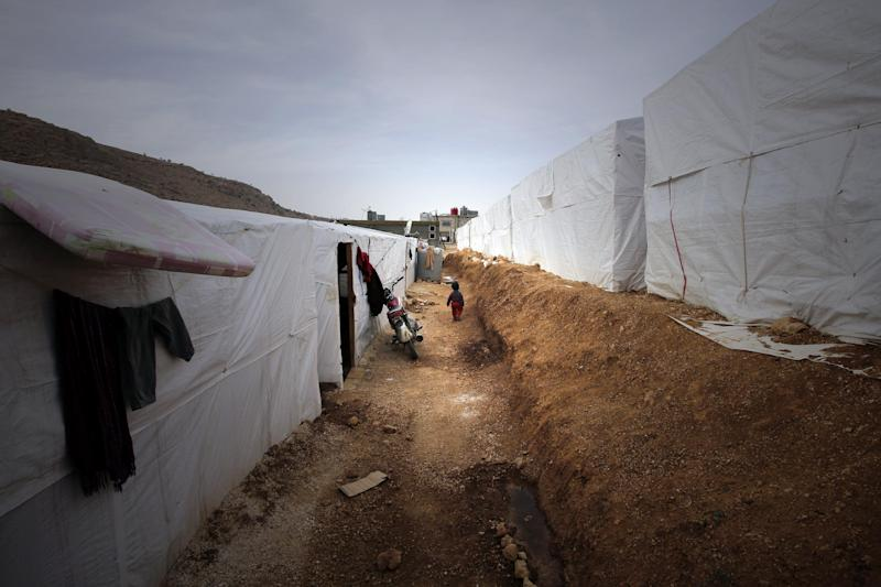 Rows of tents housing Syrian refugees at a camp in the city of Arsal in Lebanon's Bekaa valley on March 28, 2014