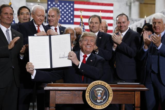 President Trump displays an executive order after announcing big cuts to Utah's sprawling wilderness national monuments, at the Utah State Capitol in Salt Lake City, Utah, on Dec. 4, 2017. (Photo: Reuters/Kevin Lamarque)