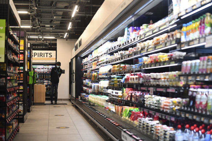 The Amazon Fresh grocery store opens in London, Thursday March 4, 2021, where shoppers will be able to pick up items and walk out of the store, contactless, without the need for a till. Customers will scan a QR code on their way into the store, with cameras and technology identifying the items that shoppers take from the shelves and their account automatically paid. (Victoria Jones/PA via AP)