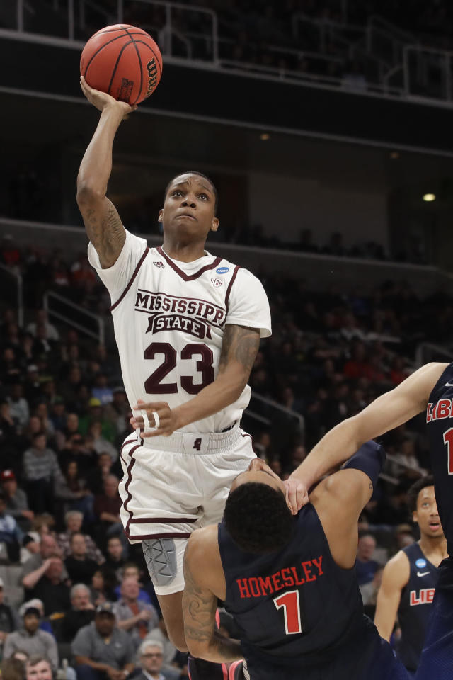 Mississippi State guard Tyson Carter shoots over Liberty guard Caleb Homesley during the second half of a first-round game in the NCAA mens college basketball tournament Friday, March 22, 2019, in San Jose, Calif. (AP Photo/Jeff Chiu)