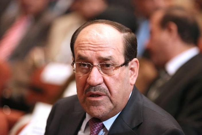 Iraq's ex-premier and current vice president Nuri al-Maliki is named among officials responsible for jihadists overruning Mosul, in a parliamentary report (AFP Photo/Hadi Mizban)