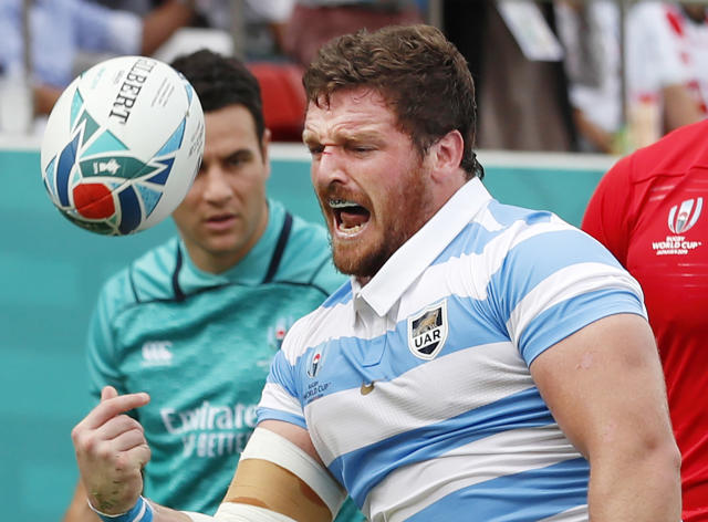 Argentina's Julian Montoya celebrates after scoring his team's first try during the Rugby World Cup Pool C game at Hanazono Rugby Stadium between Tonga and Argentina in Osaka, Japan, Saturday, Sept. 28, 2019 (Kyodo News via AP)