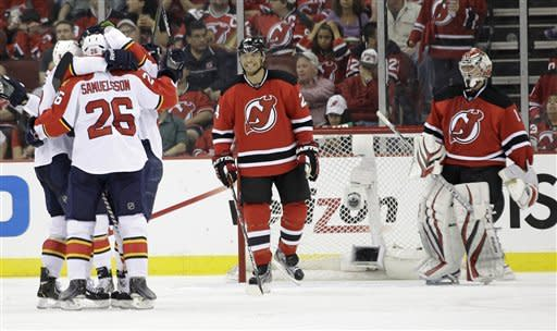 Panthers rally from 3-0 hole, defeat Devils, 4-3