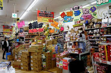 Shoppers browse products at Japanese discount retailer Don Quijote Holdings' store in Tokyo, Japan, June 18, 2018. Picture taken on June 18, 2018. REUTERS/Kim Kyung-Hoon