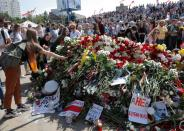 People gather to commemorate a killed protester in Minsk