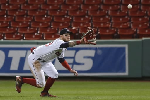 Boston Red Sox's Alex Verdugo makes the catch on the line out by Toronto Blue Jays' Danny Jansen during the ninth inning of a baseball game, Friday, Aug. 7, 2020, in Boston. (AP Photo/Michael Dwyer)