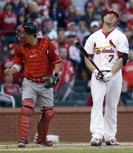 St. Lois Cardinals' Matt Holliday, right, reacts after striking out to end Game 1 of the National League division baseball series on Sunday, Oct. 7, 2012, at Busch Stadium in St. Louis, Mo. Nationals catcher Kurt Suzuli, left, reacts. (AP Photo/The St. Louis Post-Dispatch, Chris Lee) EDWARDSVILLE INTELLIGENCER OUT; THE ALTON TELEGRAPH OUT