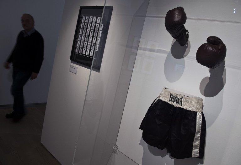 """The boxing gloves and shorts used in the film """"Raging Bull"""" (1980) are on display at the Martin Scorsese exhibition at the Deutsche Kinemathek Museum for Film and Television in Berlin on January 9, 2013. A Berlin museum will Wednesday open what it called the first exhibition worldwide dedicated to the work of veteran US film-maker Martin Scorsese, who opened his vast archive for the show"""