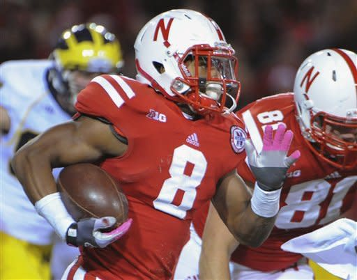 Nebraska's Ameer Abdullah (8) carries the ball in the second half of an NCAA college football game against Michigan in Lincoln, Neb., Saturday, Oct. 27, 2012. Nebraska won 23-9. (AP Photo/Dave Weaver)