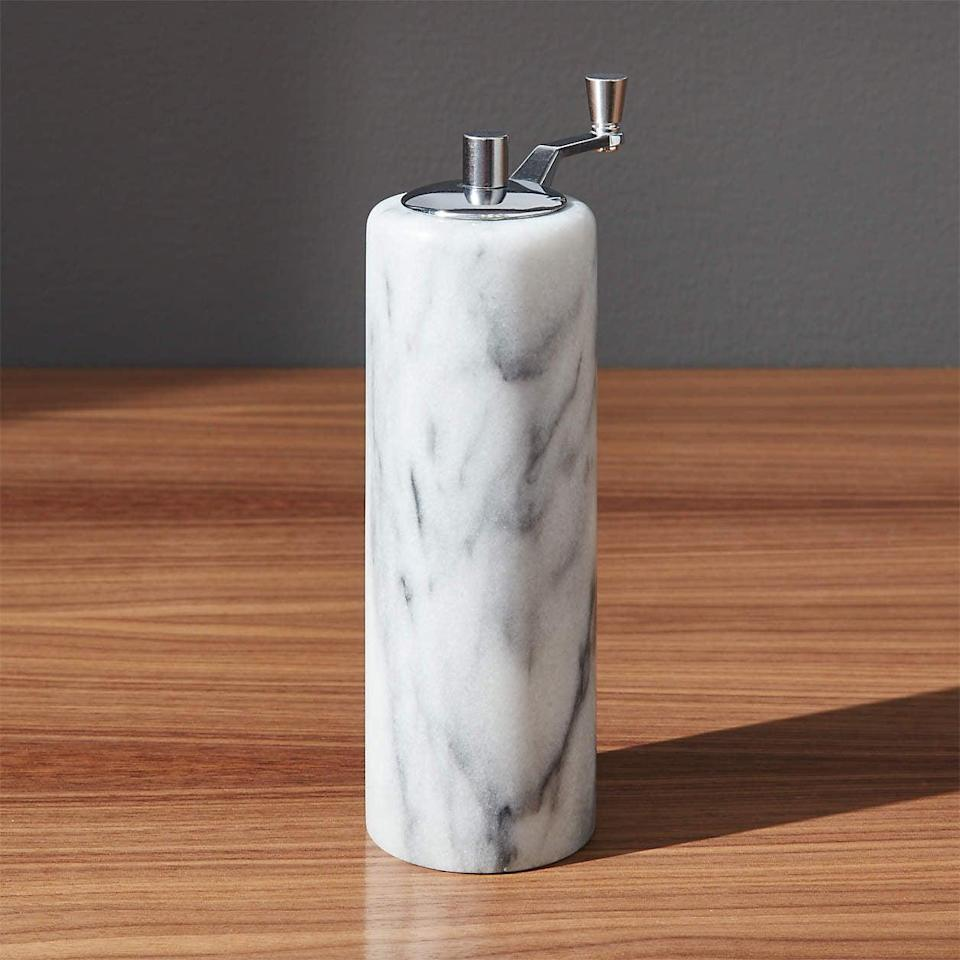 <p>This <span>French Kitchen Marble Pepper Mill</span> ($25) will fit nicely with the rest of your accessories.</p>