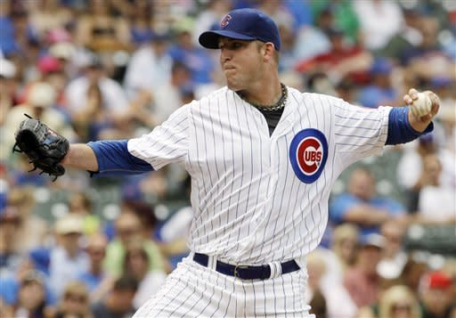 Chicago Cubs starter Paul Maholm throws against the Houston Astros during the first inning of a baseball game in Chicago, Friday, June 29, 2012. (AP Photo/Nam Y. Huh)