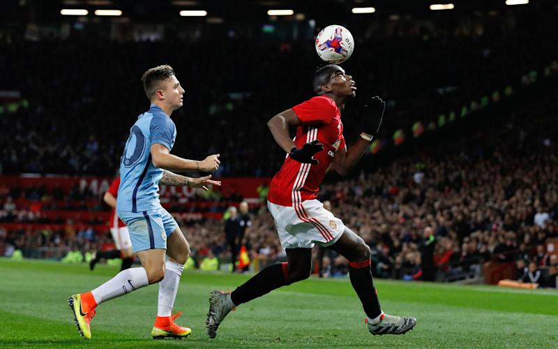 Paul Pogba would have been in the light blue of City on Thursday night if Yaya Toure had got his way - Credit: Martin Rickett/PA