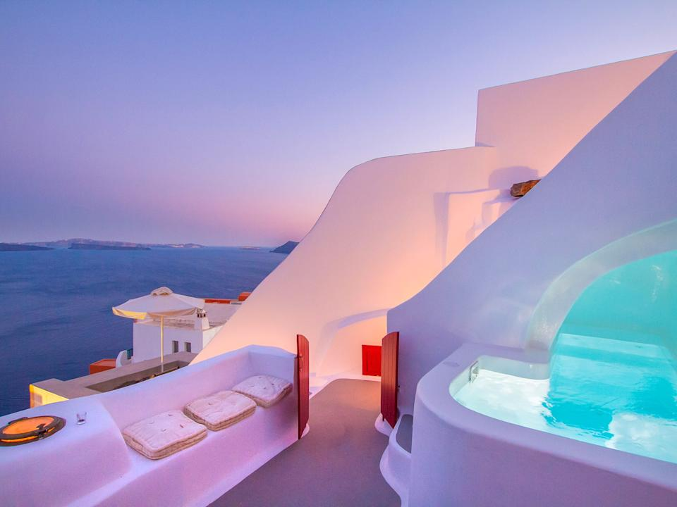 A breathtaking historic Grecian hillside cave house in Santorini, Greece. Photo: supplied.