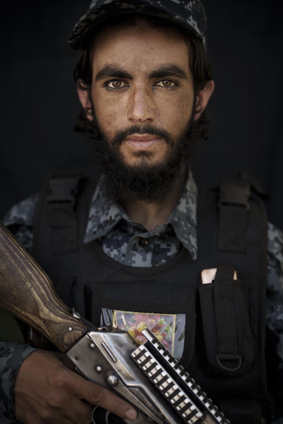 Taliban fighter Nazir Ahmed, 22, poses for a photo wearing a new police uniform in Kabul, Afghanistan, Thursday, Sept. 16, 2021. Ahmed is from Parwan province and has been with Taliban forces for 5 years. (AP Photo/Felipe Dana)