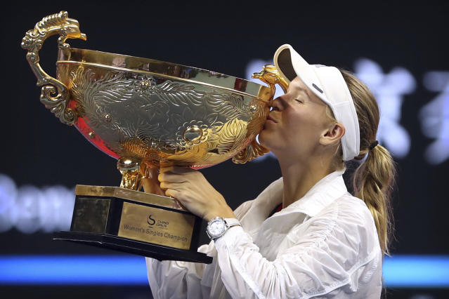 Caroline Wozniacki of Denmark kisses the winner's trophy after beating Anastasija Sevastova of Latvia in the women's singles final in the China Open at the National Tennis Center in Beijing, Sunday, Oct. 7, 2018. (AP Photo/Mark Schiefelbein)