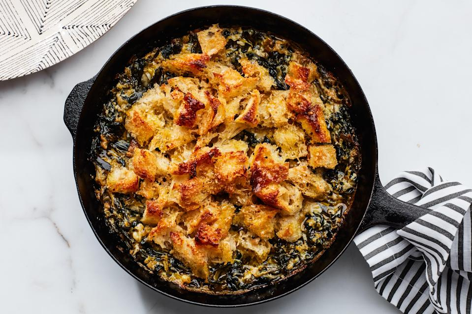 """The contents of this cast iron skillet demonstrate the best way to eat your greens: with creamy, cheesy leeks, of course! <a href=""""https://www.epicurious.com/recipes/food/views/spring-greens-and-leek-gratin?mbid=synd_yahoo_rss"""" rel=""""nofollow noopener"""" target=""""_blank"""" data-ylk=""""slk:See recipe."""" class=""""link rapid-noclick-resp"""">See recipe.</a>"""