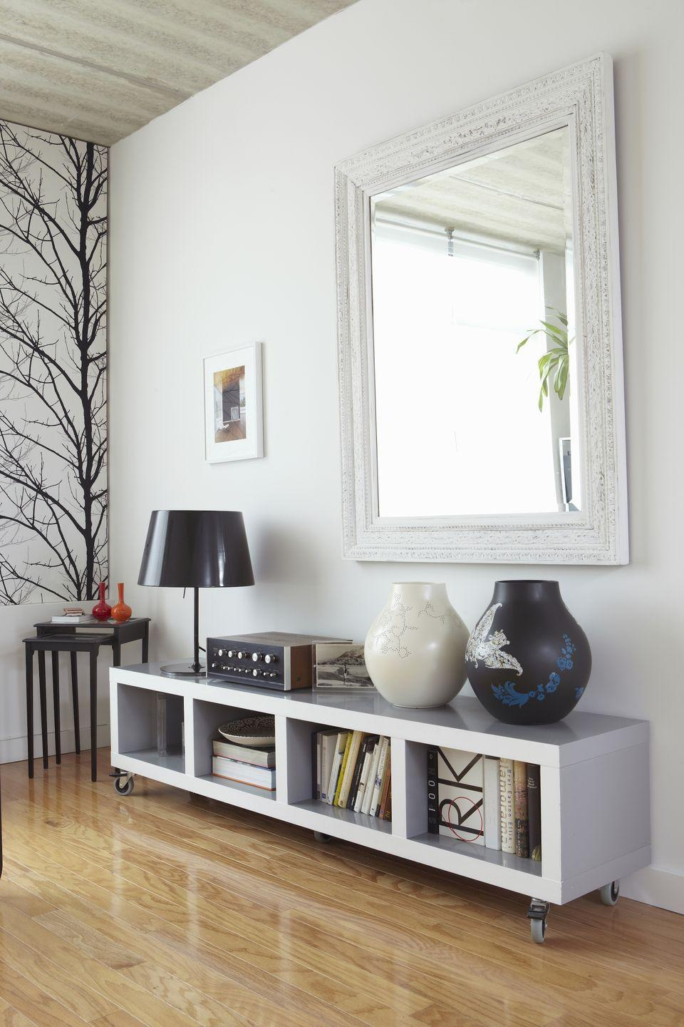 """<p>Double the amount of sunlight in your room by allowing it to bounce off reflective surfaces. Hang a large <a href=""""https://www.elledecor.com/design-decorate/room-ideas/g3037/bathroom-mirrors/"""" rel=""""nofollow noopener"""" target=""""_blank"""" data-ylk=""""slk:mirror"""" class=""""link rapid-noclick-resp"""">mirror</a> directly across from the largest window in your room, or arrange an array of smaller mirrors to help brighten a dark staircase, suggests <a href=""""http://www.houzz.com/ideabooks/8791544/list/so-you-bought-a-cave-7-ways-to-open-your-home-to-light"""" rel=""""nofollow noopener"""" target=""""_blank"""" data-ylk=""""slk:Houzz"""" class=""""link rapid-noclick-resp"""">Houzz</a>. </p>"""