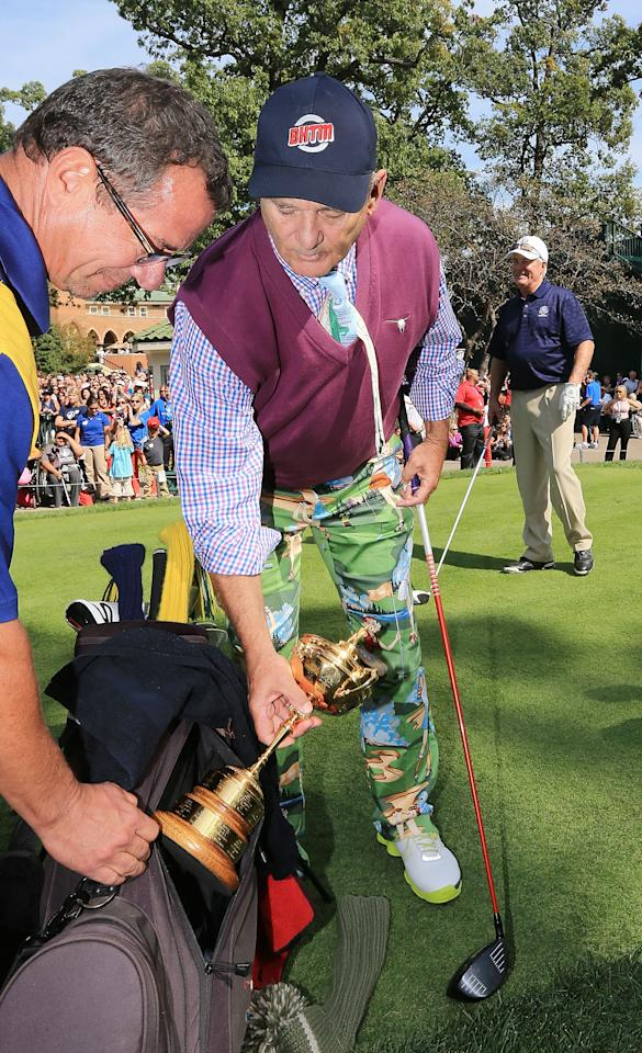 MEDINAH, IL - SEPTEMBER 25:  Hollywood star Bill Murray clowns around with the Ryder Cup on the first tee during the 2012 Ryder Cup Captains & Celebrity Scramble at Medinah Country Golf Club on September 25, 2012 in Medinah, Illinois.  (Photo by David Cannon/Getty Images)