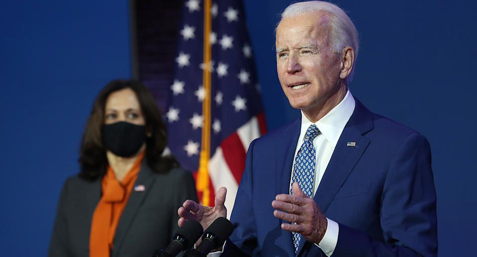 WILMINGTON, DELAWARE - NOVEMBER 09:  U.S. President-elect Joe Biden speaks to the media while flanked by Vice President-elect Kamala Harris, at the Queen Theater after receiving a briefing from the transition COVID-19 advisory board on November 09, 2020 in Wilmington, Delaware. Mr. Biden spoke about how his administration would respond to the coronavirus pandemic. (Photo by Joe Raedle/Getty Images)