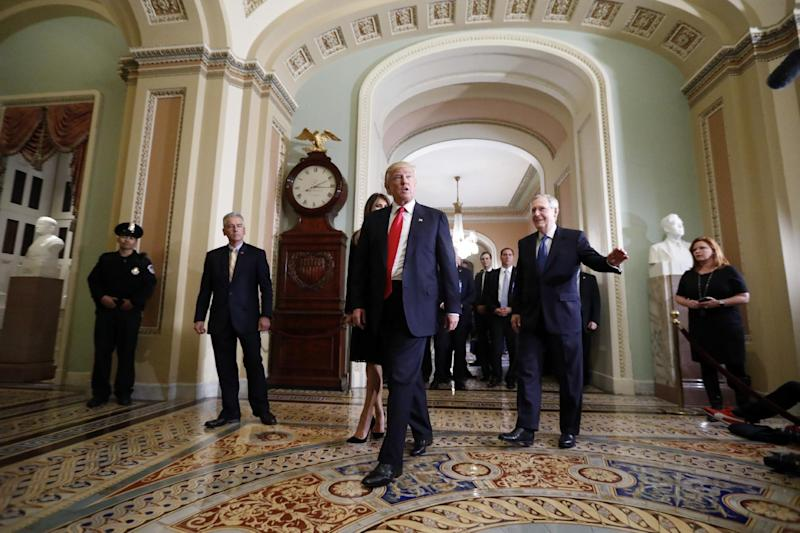 FILE - In this Nov. 10, 2016 file photo, President-elect Donald Trump, center, walk with Senate Majority Leader Mitch McConnell of Ky. after a meeting on Capitol Hill in Washington. For eight years, a leaderless Republican Party has rallied around its passionate opposition to President Barack Obama and a rigid devotion to small government, free markets and fiscal discipline. No more. On the eve of his inauguration, Donald Trump is remaking the Republican Party in his image, casting aside decades of Republican orthodoxy for a murky populist agenda that sometimes clashes with core conservative beliefs. (AP Photo/Alex Brandon, File)