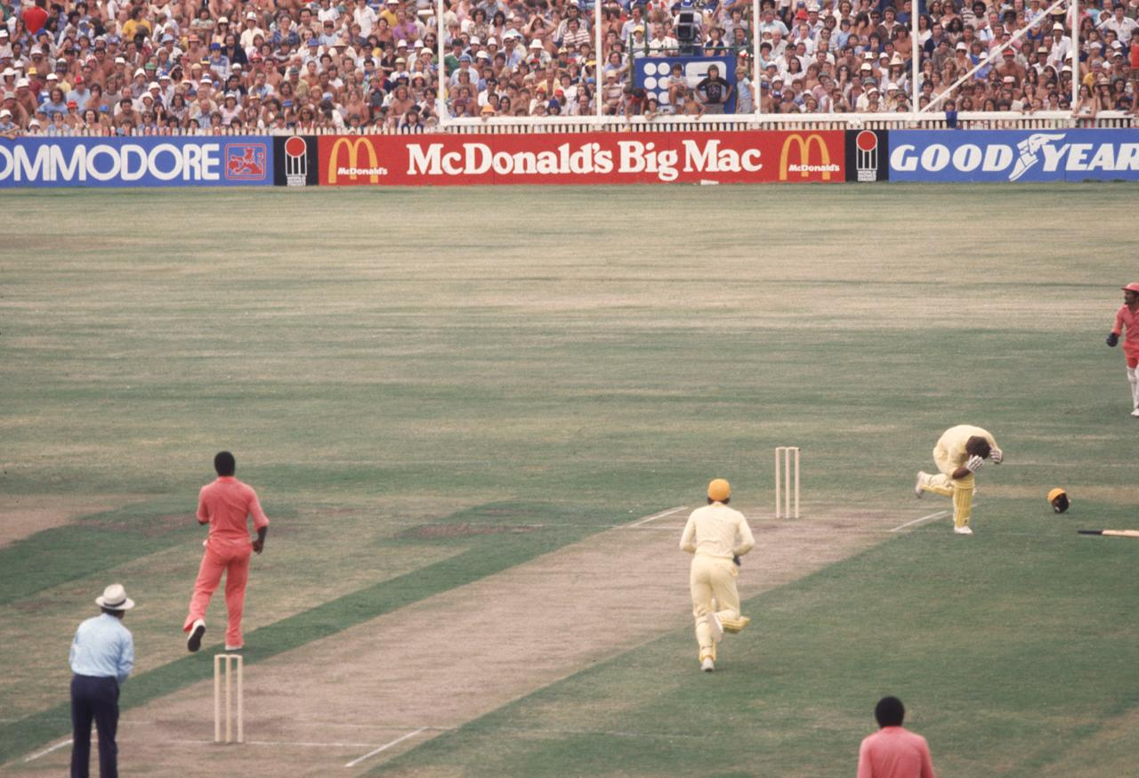 Australian batsman Rodney Marsh is struck by a bouncer from West Indian bowler Wayne Daniel during a one day international in Sydney, January 1979. (Photo by Adrian Murrell/Getty Images)