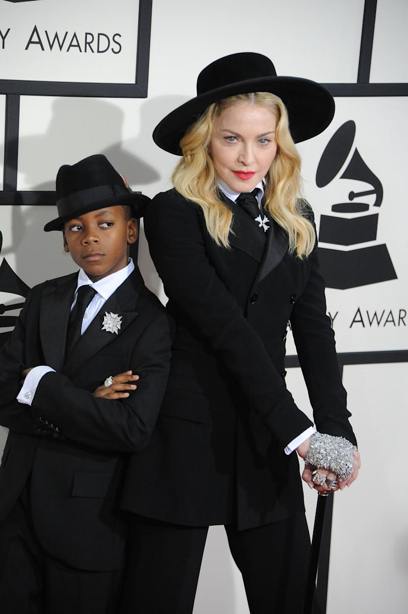 Singer Madonna and David Banda arrive at the 56th GRAMMY Awards held at the Staples Center. (Photo by Frank Trapper/Corbis via Getty Images)