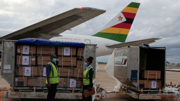 Workers offload Zimbabwe's first batch of COVID-19 vaccines from China on Feb. 15.