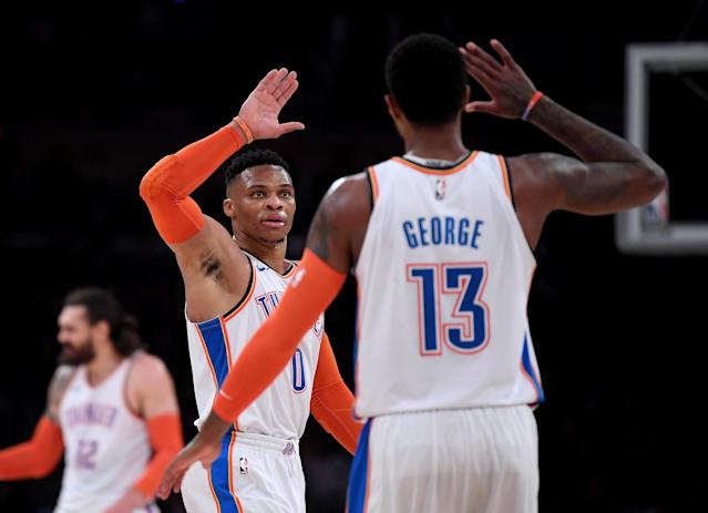 Russell Westbrook and Paul George will face their former team from different cities. (Getty)