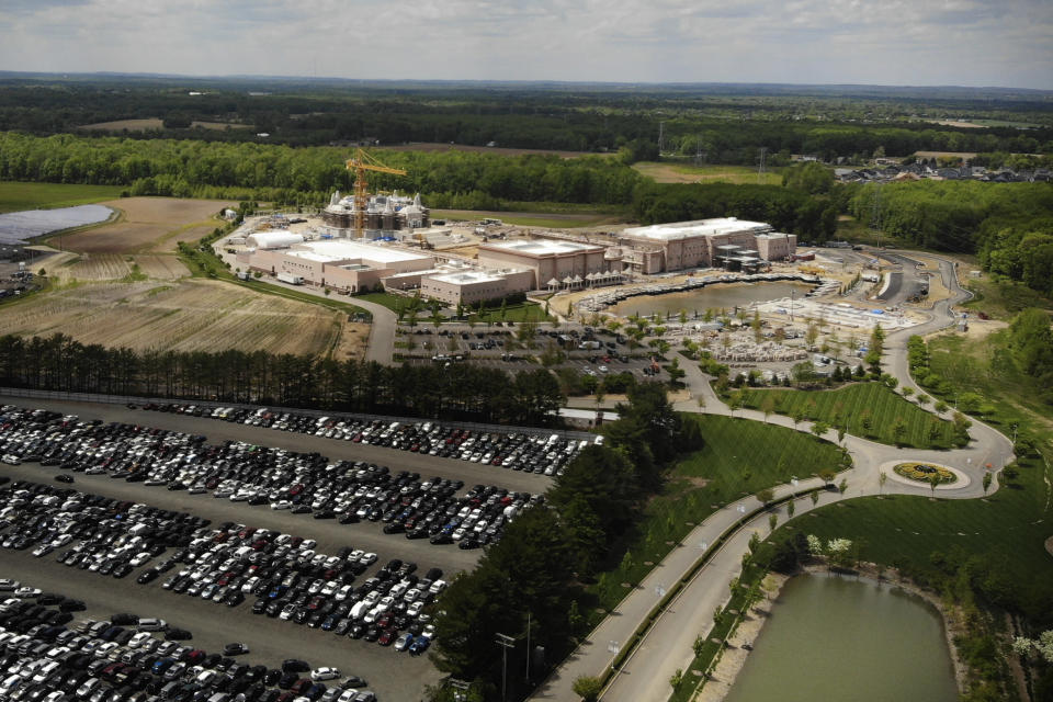 This aerial image taken with a drone shows the BAPS Shri Swaminarayan Mandir in Robbinsville Township, N.J., Tuesday, May 11, 2021. Workers from marginalized communities in India were lured to the U.S. and forced to work long hours for just a few dollars per day to help build the Hindu temple in New Jersey, according to a lawsuit filed Tuesday, May 11, 2021. The lawsuit filed in federal court accuses the leaders of the Hindu organization known as Bochasanwasi Akshar Purushottam Swaminarayan Sanstha, or BAPS, of human trafficking and wage law violations. (AP Photo/Ted Shaffrey)