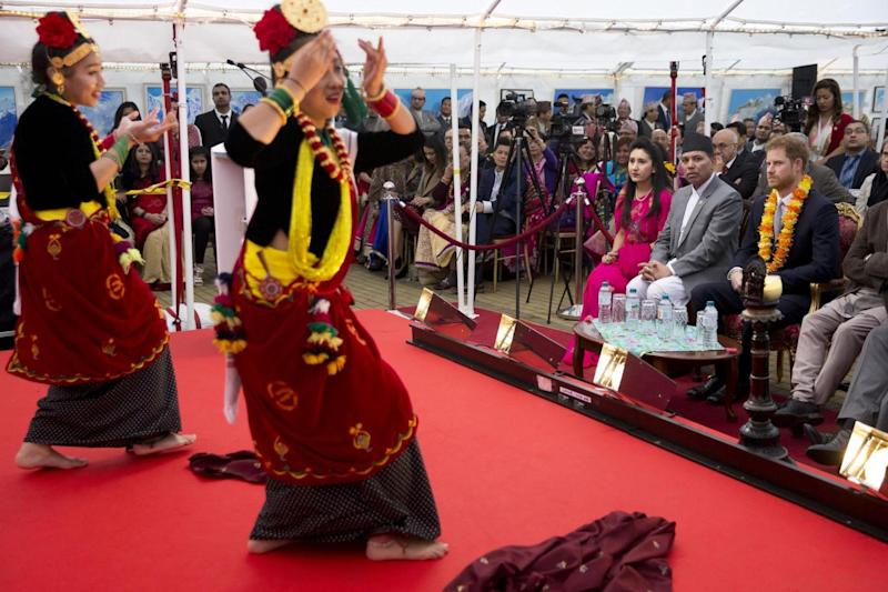 Celebration: Harry watches a Nepali cultural performance (Getty Images)